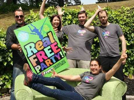 Community radio station FreeFM staff get in the mood to celebrate its first 21 years ( from left) Phil Grey, Lara Signal, John Armistead and Josh Drummond with Women's Voice host Chilean Silvana Erenchun on the couch.