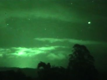The strange lights captured on film here over Rotorua may just be chinese lanterns sent up in a remembrance ceremony.