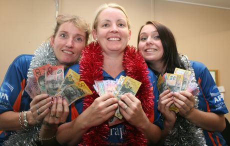 CHRISTMAS CASH: Central Telegraph's Lynette Stark, Stacey Rudd and Rebekah Green with some of the cash that will be given away in Santa's Stash of Cash giveaway. Photo Cameron McCrohon / Central Telegraph