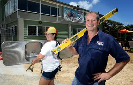 Treena Wright and Paul Gillespie work on the Fingal Head surf club. Photo: John Gass / Daily News
