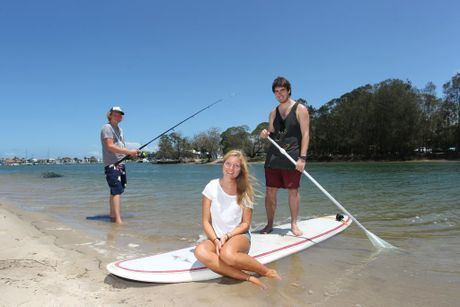 Backpackers Thijs Kolman from Holland, left, Noemi Perrault from Canada and Miles Edmunds from England, enjoy their time at Mooloolaba. A new study has come out revealing international visitors spent $190 million on the coast for the year ending September 30.