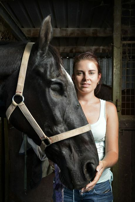 Amanda Vella holds Jet a rescue horse who has lost an eye. Amanda is the founder of Save A Horse, a horse rescue and sanctuary charity who rescue poorly treated and emaciated horses from the slaughter yard. Photo: Claudia Baxter / The Queensland Times