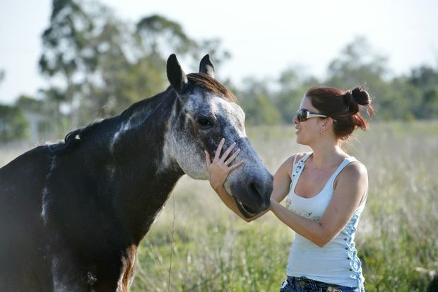 Amanda Vella strokes rescue horse Chyanne. Amanda is the founder of Save A Horse, a horse rescue and sanctuary charity who rescue poorly treated and emaciated horses from the slaughter yard. 