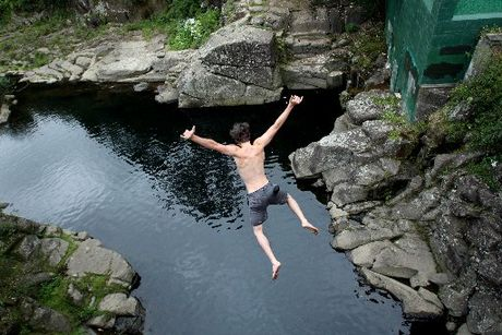 A self-confessed thrillseeker leaps off the McLaren Falls Bridge.