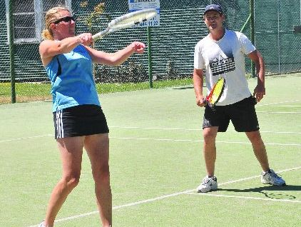 TOP SPIN: Martinborough's Rhona Lovell hits out as her doubles partner Tim Pickering looks on.
