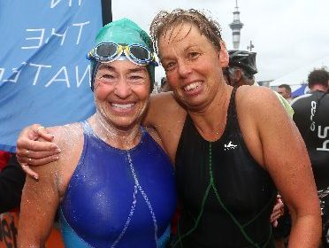 Pam Dickson (left) and Heather Osborne after finishing the Auckland Harbour swim. Photo / Simon Watts