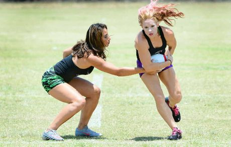 GAME ON MOVE: Ladies Football League founder Tala Schultz (left) runs through some drills with Dallas Diamonds player and former US women's national team player Jen Welter.
