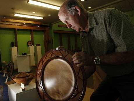Jim Maloney, of Northland Woodturners and Woodworkers, sets up a display in the shop.