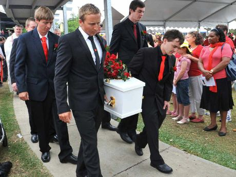Pallbearers Matt Hannah (from left) and Scott Balkin (front right), Josh Hannah (second row left) and Tom Palmer (second row right) and Daniels brothers Bradley and Dean (at rear obscured) carry Daniel to his final resting place.