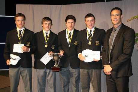 The Boys' High golf team, pictured with former Warrior Logan Swann (right) at their school prizegiving. Photo / Supplied