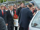 THE Sunshine Coast community stood shoulder to shoulder in a guard of honour  as they said farewell to Daniel Morcombe, nine years to the day he went missing.