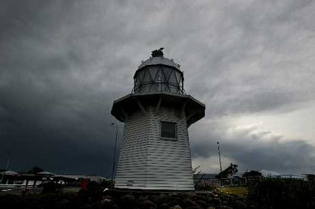 STORM SENTRY: Wairoa's lighthouse foregrounds the stormy skies yesterday about 4pm. PHOTO/WARREN BUCKLAND HBT124336-5
