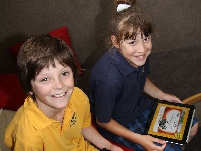 BOOST: South New Brighton School pupils Mason Coultas, 10 and Renee Annan, 9, with the digital devices the 