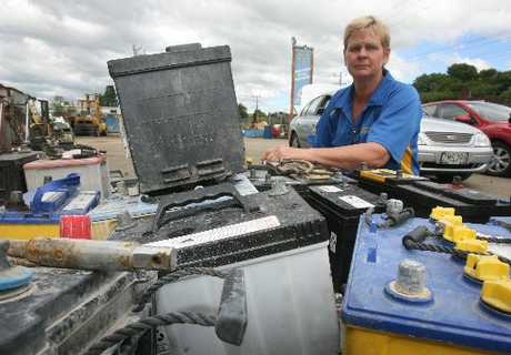 INVASION: Wairarapa Scrap Metals owner Janice O'Brien with car batteries which were left behind when the yard was burgled yesterday. PHOTO/LYNDA FERINGA