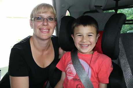 SAFE AND SOUND: Masterton mum Kelly Tovio with 6-year-old Dylan. The pair were involved in a car accident when Dylan was 6 weeks old and she is now very careful about child restraints.