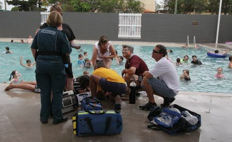 A pool lifeguard assists a young boy who got into difficulty at the Maryborough Aquatic Centre on opening day.