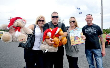 Bikers Traci Ryman, Doug Hurley, Richelle Grant and Jon Wood assisted Santa Claus with donations at the Salvos toy run.