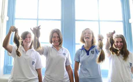 HAIRS TO CHARITY: Samantha Limbert, Krystal King, Acacia Endean and Kate Sneesby had 20 centimetres of hair cut off to make wigs for cancer sufferers. Photo: JoJo Newby