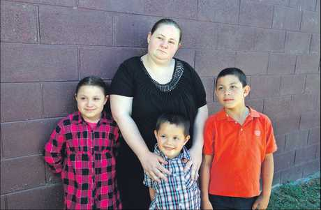 Megan Tuimaualuga, with her children, Elizabelle (left), Sam and Sosaia, wants people to be aware of the dangers when using gas canisters.