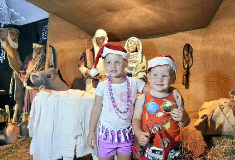 QUICK LOOK: Lacey and Lawson Pohle get a preview of the Kawana Uniting Church's annual Christmas festival.