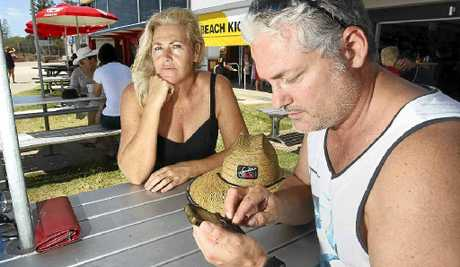 TAKE A BREAK: Brisbane's Jo and Kenny Mackenzie holidaying at Alexandra Headland, but sometimes Kenny finds it hard to leave work at work.