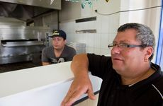 Malla & Sons Pizza and Pasta owner Giovanni Mallamaci (right) and son Joshua were threatened with a knife during an attempted armed robbery on Friday night.