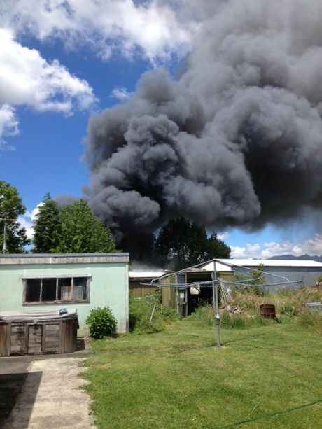 Thick smoke bellowed from a shed that had caught alight in Katikati.
