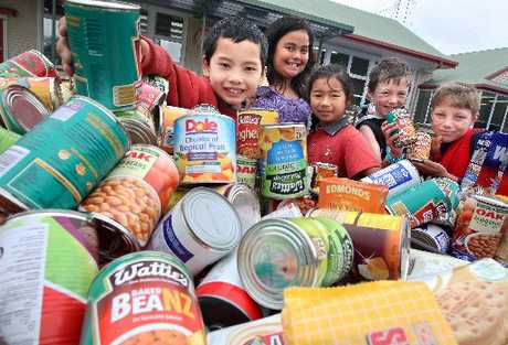 Glenholme School students (from left) Yiheng Huang, 8, Brooklyn Kingi, 8, Hana Kobori, 8, Finn Callaghan, 8, and Liam Dodge, 9, were among many of the pupils who donated an item of food to The Daily Post Christmas Appeal for the Salvation Army foodbank.