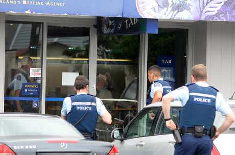 Police outside the Puriri St TAB. PHOTO/BEVAN CONLEY