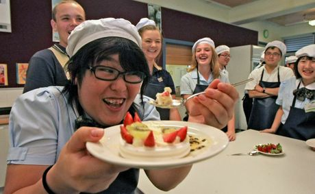 Aoba Iwanuma tries out some Aussie Pavlova at Banora Point High.