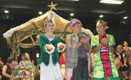 CAROLS NIGHT: Students from St Mary's Catholic College Annual Carols Night on Thursday (from left) Bridget McDonald, Leyton Brown and Harrison Lucas.