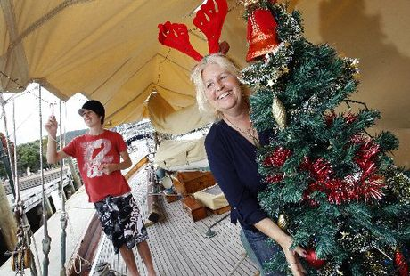 Rosemary Dyche and son David, 17, on their Christmas-decorated boat in the Whangarei Town Basin. Photo / Michael Cunningham