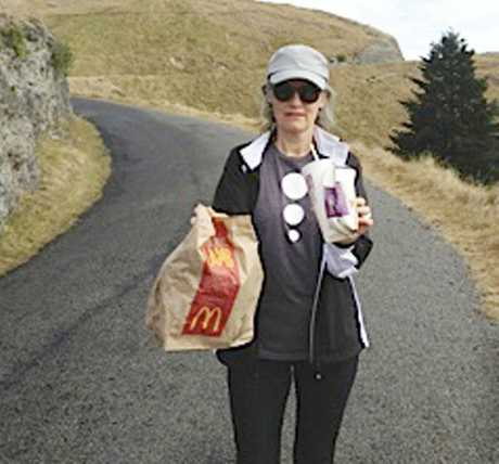 BIN IT: Te Mata park user Joh Bevin takes a load of fresh rubbish to one of the many bins in the park carparks over the weekend. PHOTO/ SUPPLIED
