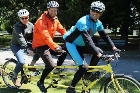 OUT FOR A SPIN: The three-seater charity cyclists rolled through Masterton on Friday - two of the trio, Jimmy Griffiths and Richard Steane, let local cyclist Steve Elgar take the back seat around Queen Elizabeth Park.