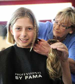 Issie Dekker gets her hair cut.