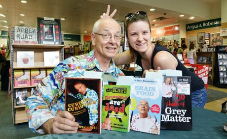 Dr Karl Kruszelnicki and Jessica McGregor pose for a photograph at Angus and Robertson in Riverlink Shopping Centre, Ipswich. Dr Karl signed copies of his new book 50 Shades of Grey Matter for science fans.