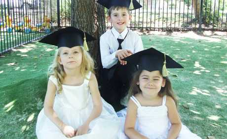 Maggie Parslow, Shaun Wilkins and Mia Jorda graduate from pre-Prep at Play and Learn Mulberry Tree.