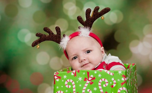 Baby Benjamin Barwick celebrates his first Christmas with a fun, festive photograph. Photograph: Annielyn Images