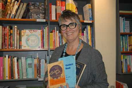 Alexa Johnston with the old style cookery books she used for inspiration.