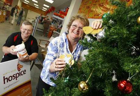 Volunteers Christine and Bruce Aberdeen with one of the Memory Trees. Photo / Michael Cunningham