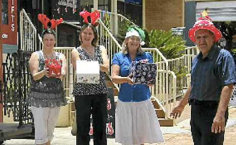 Chamber of Commerce secretary Corrie McColl (right) with Santa's helpers Lee Prince, Rhonda Acworth and Wendy Reid.