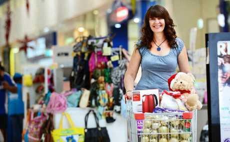 SPENDING UP: Christine Berry, of Flinders View, starts her Christmas shopping spree at Riverlink Shopping Centre.