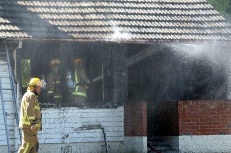 HOT MORNING'S WORK: Firefighters and police attended their third job for the morning, this time a fire on Seddon Cres in Maraenui, Napier, which destroyed one of four units in a flat complex. PHOTO/PAUL TAYLOR HBT124627-04.