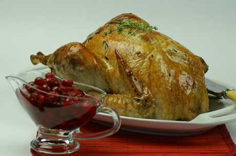 Roast turkey with sausage stuffing and cranberry sauce.