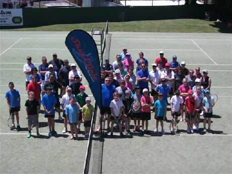 CLASH OF AGES: Participants in the popular Shoe Clinic parent-child tournament face the camera at the Masterton Tennis Centre.