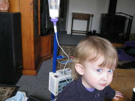 LITTLE BATTLER: Rangiora toddler Inara Herdman with the medical pump and lifeline that provides all her nutrition.