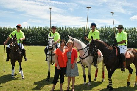 Jenni Rolton and Neralie Growcott from Harcourts Merivale, with Polo Team Two