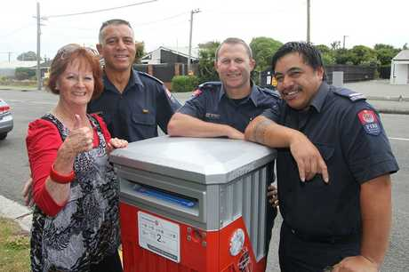 Teresa Taylor with fire station officer Mark Elstone and firefighters Sonny Fischer and Abel Esera.