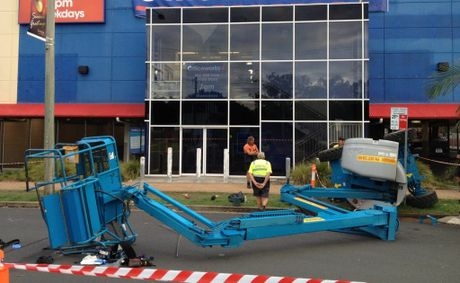 A cherry picker sits twisted outside a store in Lismore.