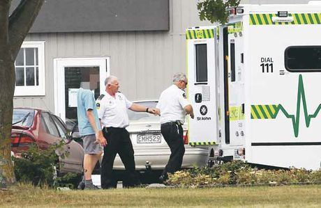 Ambulance staff help a Tamatea Intermediate school student into an ambulance. Photo / Paul Taylor